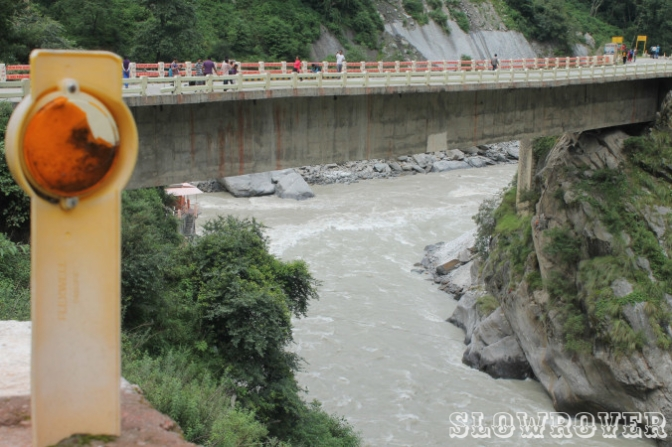 People clicking pictures around concrete structures on their way to the valley